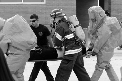 "Mock medics carry the ""injured"" off site to be cared for at Del Mar College Hospital during TIPA's live press contest's staged event. Photo by Jessica Brossack: The Signal."