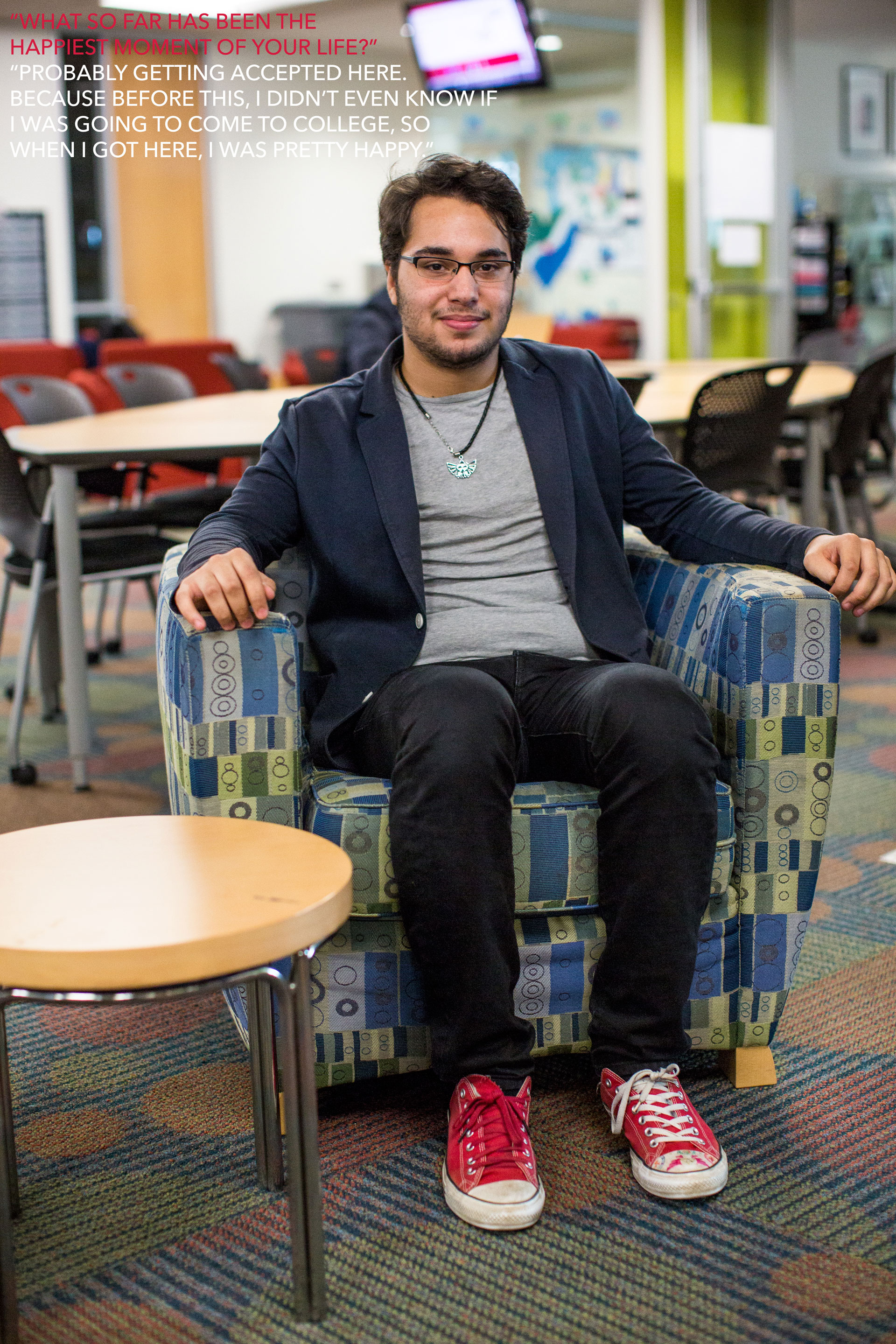 """Photo: Student Alfonso Alvarez sits in the Student Lounge in the Student Services and Classroom Building. On considering the happiest moment of his life, Alvarez says, """"Probably getting accepted here, because before this, I didn't even know if I was going to come to college, so when I got here, I was pretty happy."""" Photo & interview by The Signal reporters Maegan Hufstetler and Travis Pennington."""