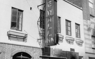 The Stonewall Inn, located in New York City's Greenwich Village, was the site of the 1969 riots. The window reads