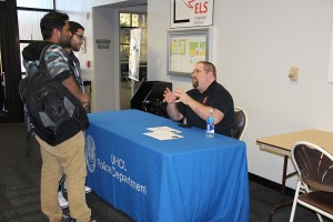 Photo: UHCL Police Sgt. Jared Goldman explains to computer engineer majors Timothy Abraham and Modesto Amaro what jugging is and how it works. Photo by The Signal reporter Raj Sheth.