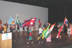 Participants of UHCL's 19th annual Cultural Extravaganza display their flags during the culture walk, which concludes the event each year.