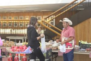 PHOTO: Jose Mireles helps a customer buy fresh fruit Photo by the Signal reporter Jaimy Jones