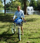 Image: Karen Barbier, associate director of university communications-media relations, on her bike that she rides to work by the pond. Photo by The Signal reporter Kyle Upton.