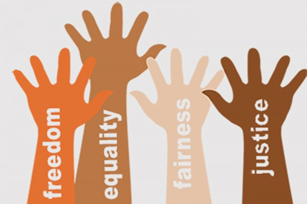 Graphic: Four hands are raised with different words on them: freedom, equality, fairness, justice. Unite against racism. Image courtesy of YWCA Spokane.