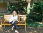 Image: Sammi Sanders, UHCL Alumni sitting on a bench at Alvin Community College. Photo by The Signal reporter Kyle Upton.