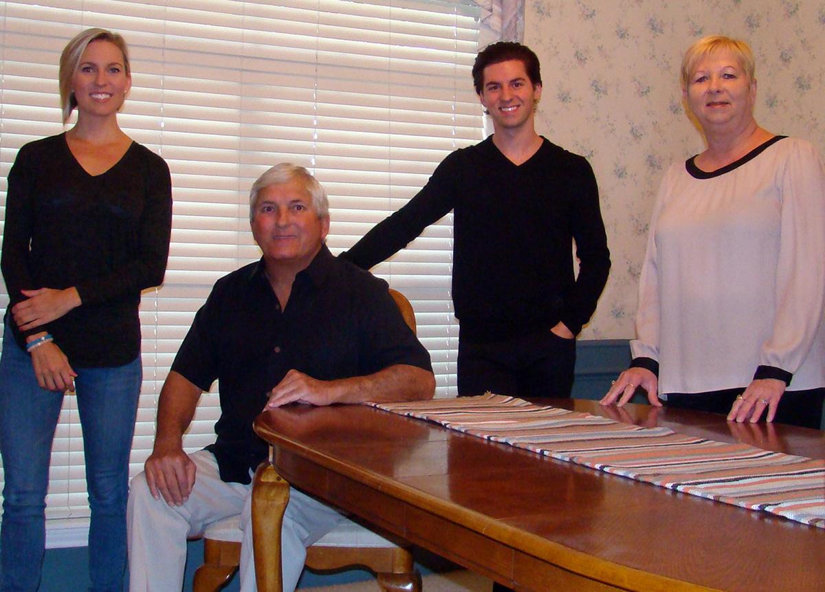 Image: The Upton family: Kayla, alumna; Steve, alumnus; Kyle, current communication major; and Karen, alumna. Photo by The Signal reporter Kyle Upton.