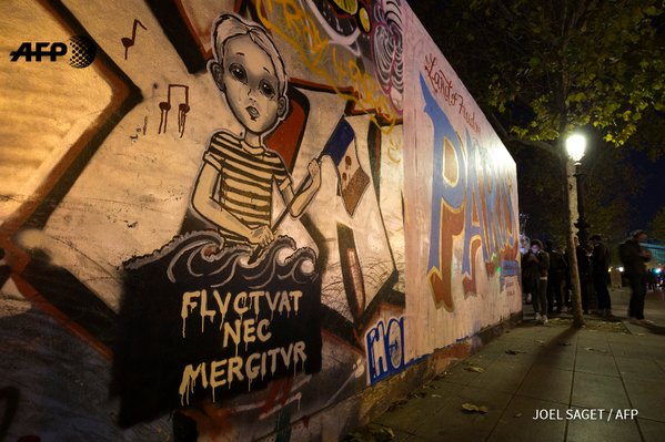 Another mural depicting the Latin phrase. Photo: Joel Saget/AFP.