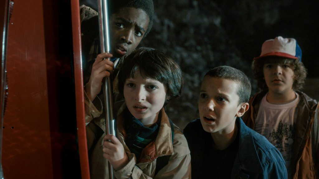 "The ""Stranger Things"" kids as they search for their friend Will. Left to right: Lucas, portrayed by Caleb McLaughlin; Mike, portrayed by Finn Wolfhard; Eleven, portrayed by Millie Bobby Brown; Dustin, portrayed by Gaten Matarazzo. Photo courtesy of Netflix."