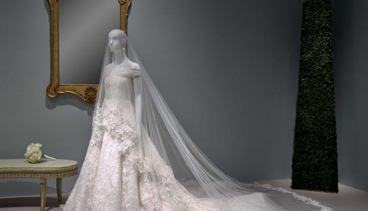 PHOTO: The last wedding gown created by Oscar de la Renta before his death, worn by Amal Clooney. Photo courtesy of Thomas R. DuBrock.