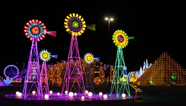 PHOTO: Colorful windmills lit as part of The Lone Star State attraction. Photo by The Signal reporter Bianca Salazar.